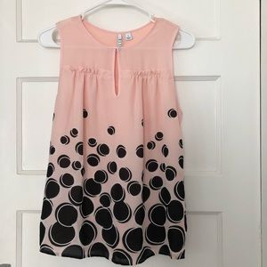 Pink, sleeveless women's top with black accents